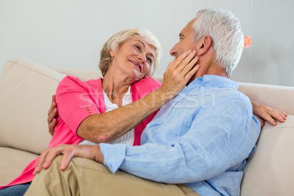 Romantikus nyugdíjas pár ül kanapé otthon Stock fotó © wavebreak_media