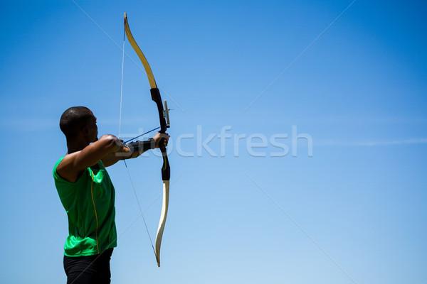 Atléta gyakorol íjászat stadion sportok fekete Stock fotó © wavebreak_media