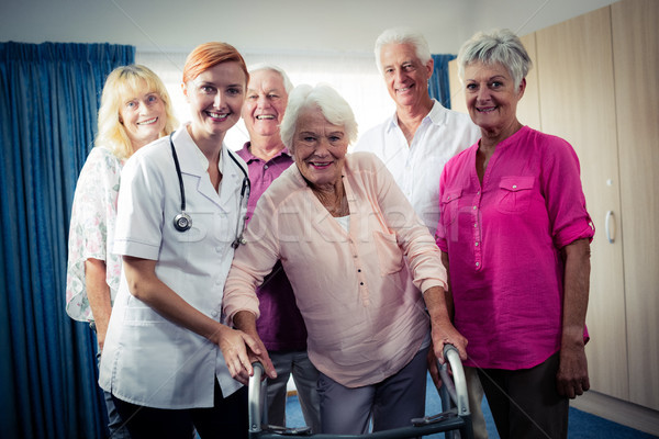 Portrait of a group of pensioners with nurse Stock photo © wavebreak_media