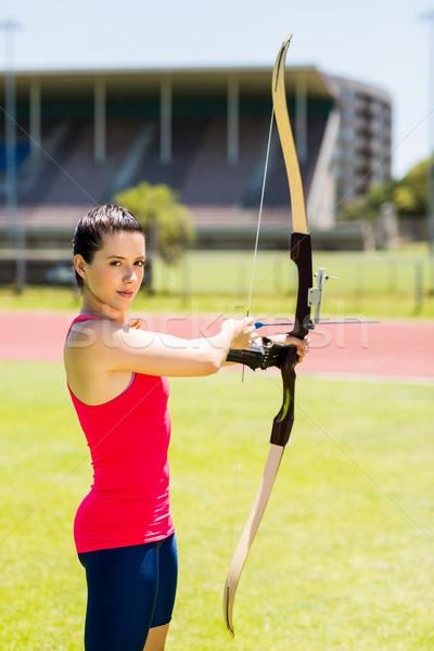 Kadın atlet okçuluk portre stadyum Stok fotoğraf © wavebreak_media
