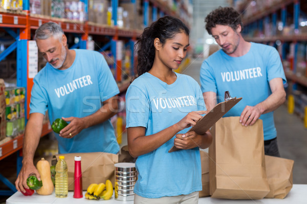 Portret wolontariusze pracy magazynu budynku człowiek Zdjęcia stock © wavebreak_media