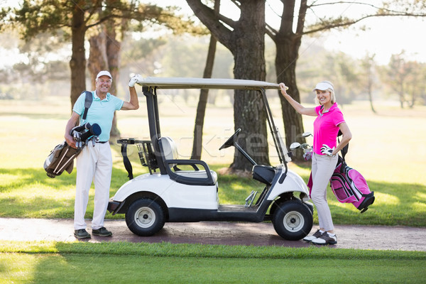 Portrait of smiling mature golfer couple Stock photo © wavebreak_media
