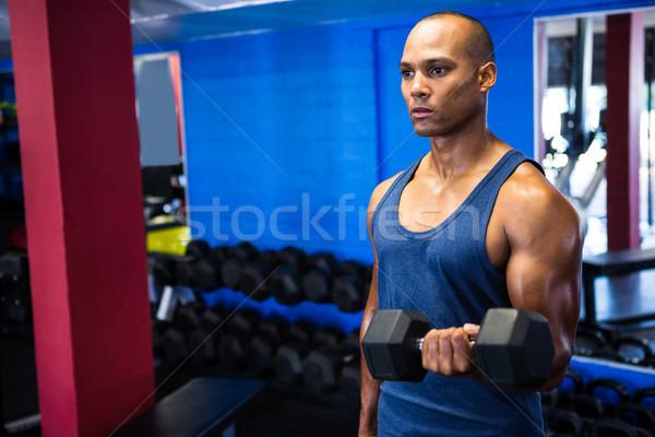 Déterminé homme haltères fitness studio Photo stock © wavebreak_media