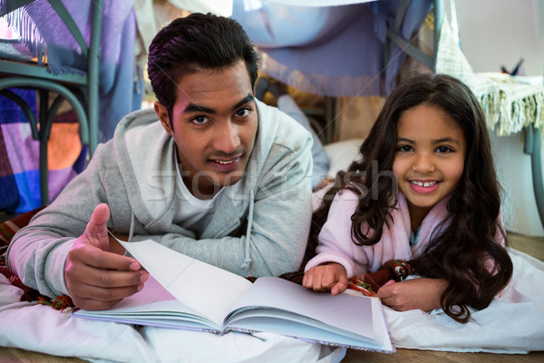 Father and daughter reading book Stock photo © wavebreak_media