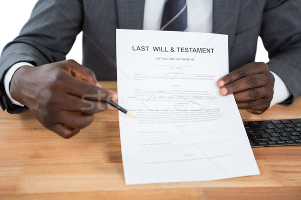 Businessman showing Last Will & Testament document Stock photo © wavebreak_media