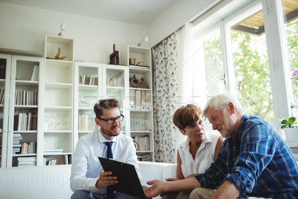 Senior couple planning their investments with financial advisor Stock photo © wavebreak_media
