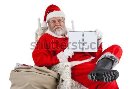 Santa claus holding envelope and handle bell Stock photo © wavebreak_media