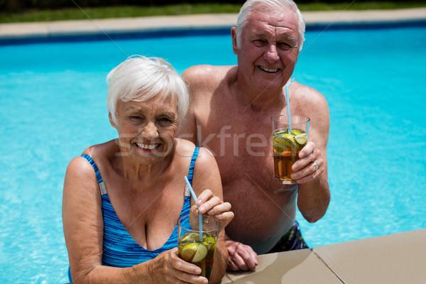 Portrait of senior couple holding glasses of iced tea Stock photo © wavebreak_media