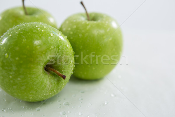 Close-up of green apples with water droplets Stock photo © wavebreak_media