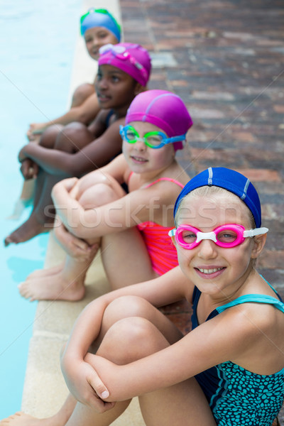 Little swimmers sitting at poolside Stock photo © wavebreak_media