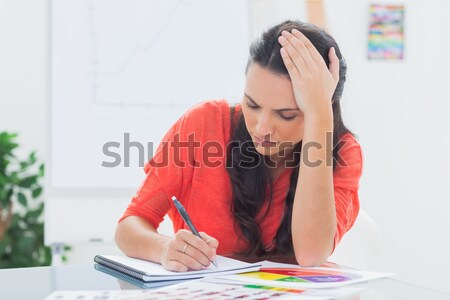Composite image of pupil writing Stock photo © wavebreak_media
