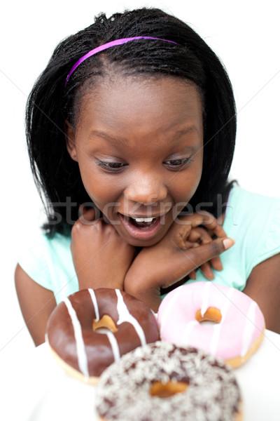 驚いた 若い女性 見える ドーナツ 白 健康 ストックフォト © wavebreak_media