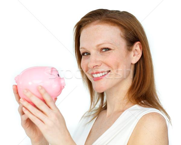 Self-assured businesswoman holding a piggybank Stock photo © wavebreak_media