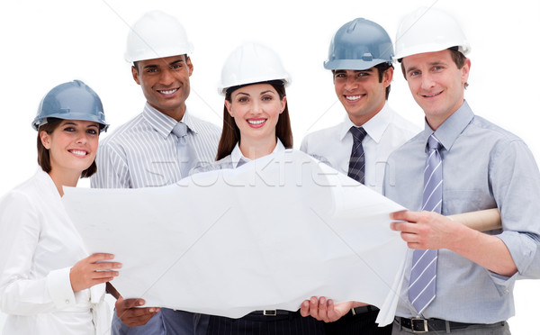 Stock photo: A diverse group of architects holding a blueprint