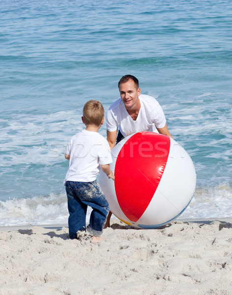 Jolly father and his son playing with a ball Stock photo © wavebreak_media