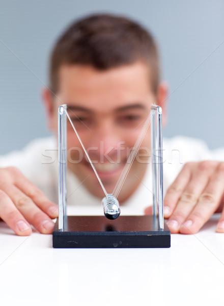 üzletember néz inga golyók iroda üzlet Stock fotó © wavebreak_media