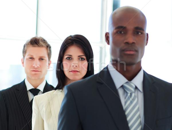 серьезный деловая женщина Focus команда линия брюнетка Сток-фото © wavebreak_media