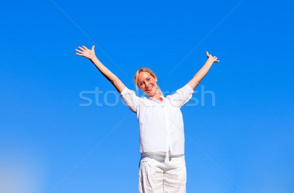 Happy woman doing exercises Stock photo © wavebreak_media