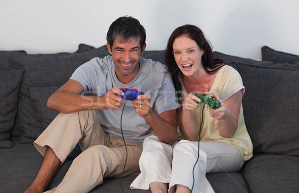 Laughing couple playing video games Stock photo © wavebreak_media