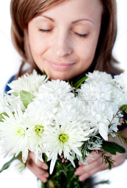 Portrait of a delighted woman holding a bunch of flowers Stock photo © wavebreak_media
