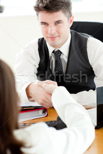 Handsome businessman closing a deal in the office  Stock photo © wavebreak_media