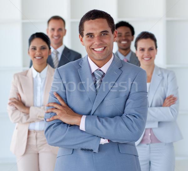 улыбаясь бизнесмен ведущий команда глядя камеры Сток-фото © wavebreak_media