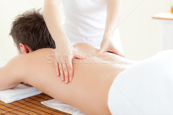 Caucsasian young  man receiving a back massage in a Spa Center Stock photo © wavebreak_media