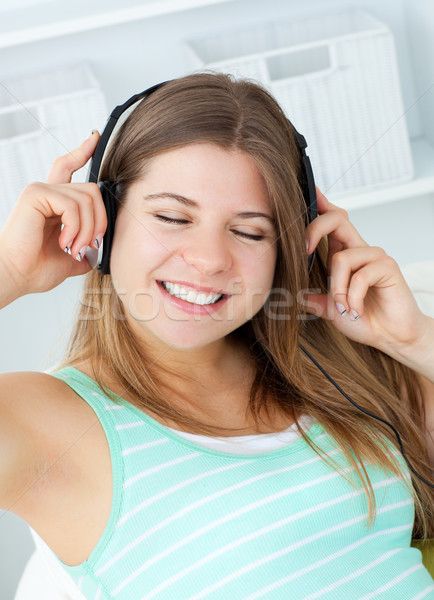 Good-looking girl listening to music at home Stock photo © wavebreak_media