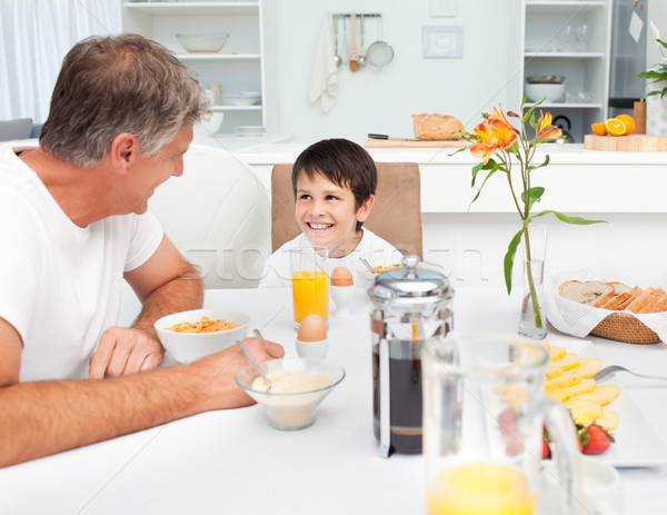 Father having his breakfast with his son at home Stock photo © wavebreak_media