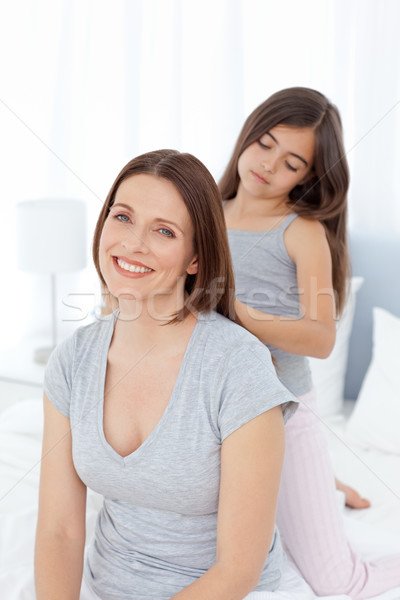Lovely daughter brushing her woman hair at home Stock photo © wavebreak_media
