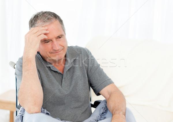Senior cadeira de rodas dor de cabeça casa médico saúde Foto stock © wavebreak_media