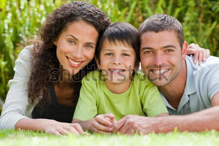 Happy family lying down in the garden Stock photo © wavebreak_media