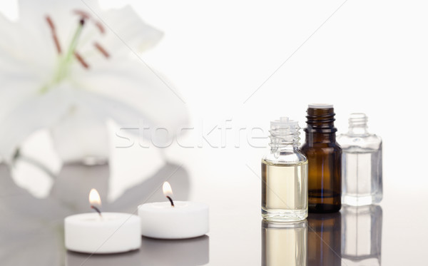 White orchid with lighted white candles and small phials th camera focus on the objects Stock photo © wavebreak_media
