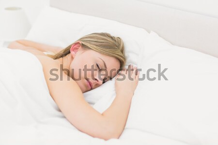 Close-up of a good looking red-haired woman sleeping in her bed Stock photo © wavebreak_media
