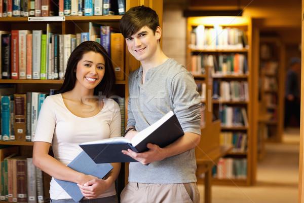 Genç Öğrenciler kitap kütüphane kitaplar öğrenci Stok fotoğraf © wavebreak_media