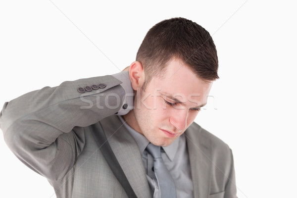 Tired young businessman against a white background Stock photo © wavebreak_media
