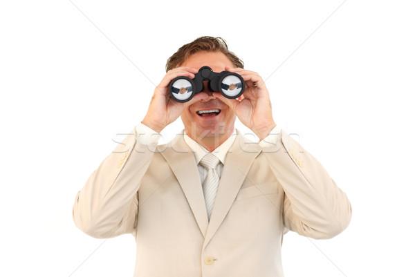 зрелый бизнесмен глядя бинокль улыбаясь камеры Сток-фото © wavebreak_media