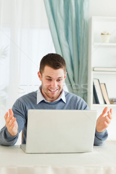 Young businessman surprised about his laptop in his homeoffice Stock photo © wavebreak_media
