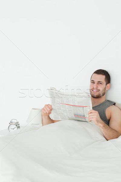 Portrait of a quiet man reading a newspaper in his bedroom Stock photo © wavebreak_media