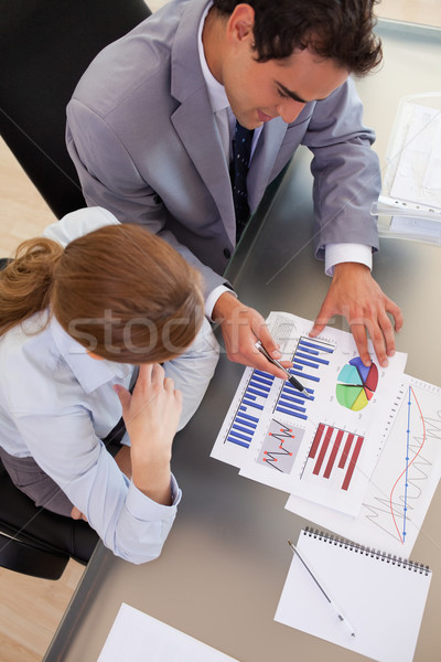 Above view of young business people working with statistics Stock photo © wavebreak_media