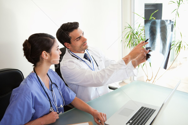 Doctors looking at a set of X-ray in an office Stock photo © wavebreak_media