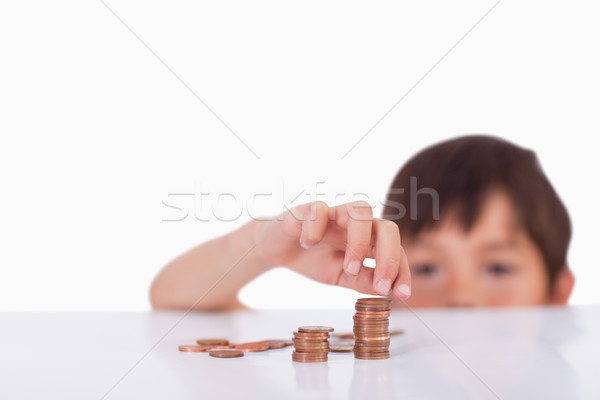 Boy counting his change against a white background Stock photo © wavebreak_media