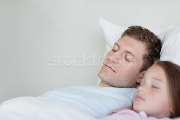 Father and daughter taking a nap next to each other Stock photo © wavebreak_media