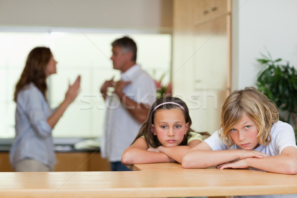 Sad looking siblings with their arguing parents behind them Stock photo © wavebreak_media