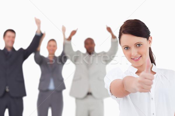 Kobieta interesu koledzy za kciuk w górę Zdjęcia stock © wavebreak_media