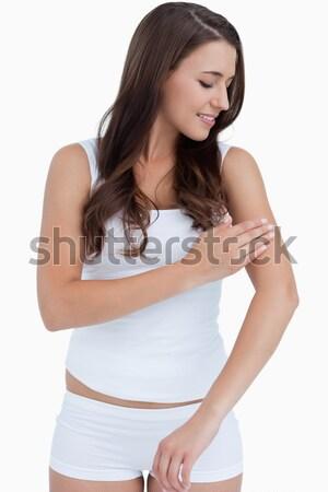Mulher creme braço branco Foto stock © wavebreak_media