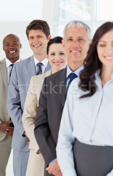 Smiling employees which are laughing while following leaders Stock photo © wavebreak_media