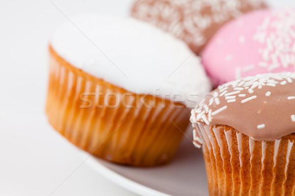 Közelkép muffinok porcukor fehér tányér háttér Stock fotó © wavebreak_media