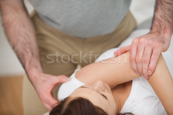 Osteopath making a joint mobilisation in his medical office Stock photo © wavebreak_media