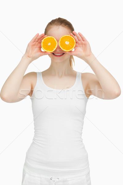 örömteli nő narancsok szemek fehér kéz Stock fotó © wavebreak_media